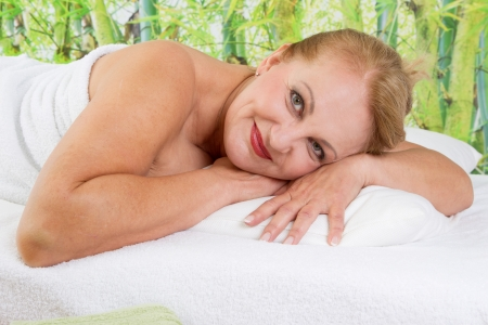 65 years old: Senior lady cheerfully at spa