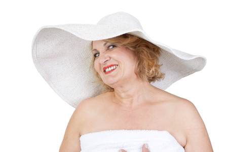 womanhood: Mature smiling lady in hat makes wellness vacation, isolated on white Stock Photo