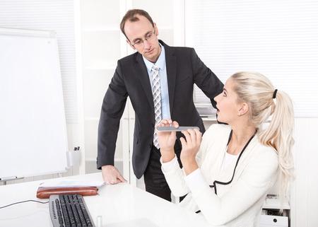 dismissal: Secretary making manicure at office - surprised boss - dismissal.