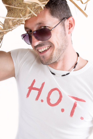 Man with HOT print on t-shirt, isolated on white photo