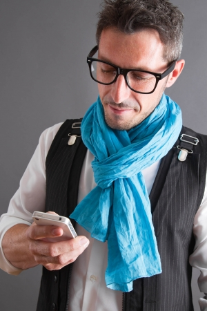 spectacle: Man typing a message on mobile phone