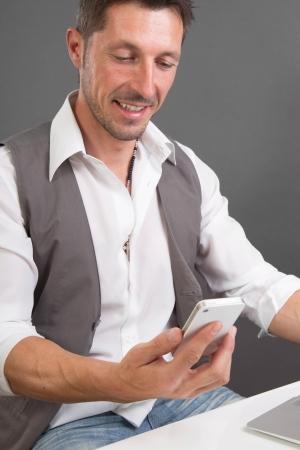 recieving: Man recieving a good message on his smartphone Stock Photo