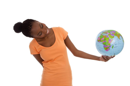 rasta colors: Black african american woman is holding a globe in her hands - isolated on white.