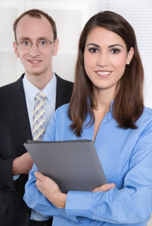 intelligent partnership: Teamwork: portrait of young successful businesspeople. Stock Photo