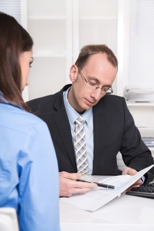 bank manager: Staff - recruitment. Businessman in an interview rucruiting staff. Stock Photo