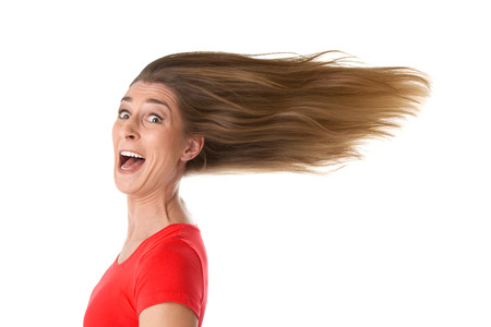 grimace:  Pure joy - isolated woman in the wind Stock Photo
