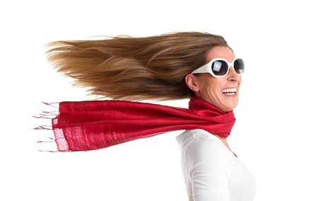 flowing hair:  Wind - isolated woman with flowing hair in red Stock Photo