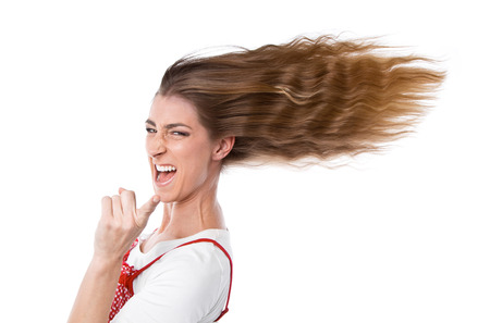humorously: Happy woman in summer - hair in wind - isolated on white Stock Photo