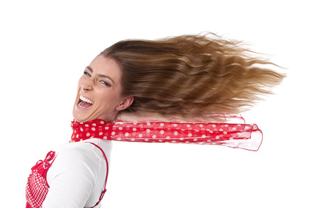 humorously:  Happy woman in summer - hair in wind - isolated on white