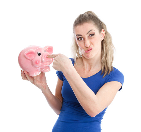 unloved:  Unloved piggy bank - Woman with grimace and money box Stock Photo