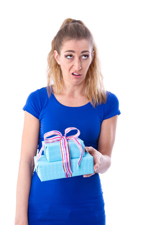 abhorrence: Disappointed woman with gift in hand - isolated on white Stock Photo