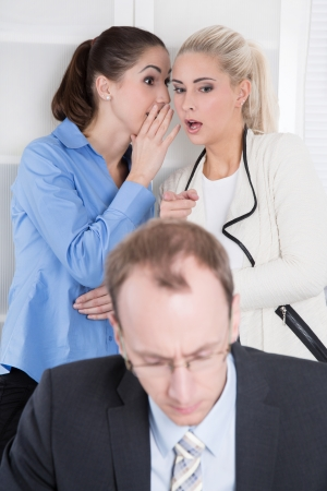 solitariness: Bullying at workplace - woman talking about his boss or colleague. Stock Photo
