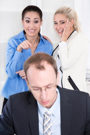 bully: Bullying at workplace - woman talking about his boss or colleague. Stock Photo