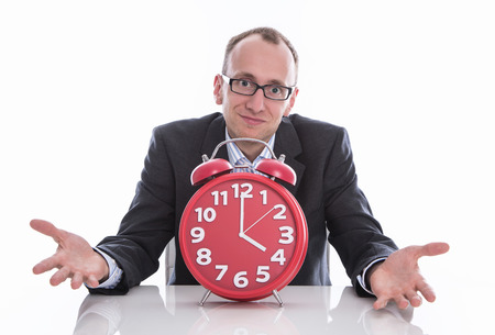 time out: Business man with clock - time is running out Stock Photo