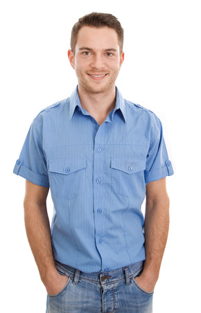 Cheerful young man with blue shirt and jeans - isolated on white Stock Photo