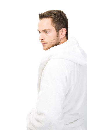 manhood: Man in bathrobe looking away - isolated on white