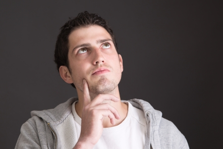 looking after: Thoughtful young man - gesture Stock Photo