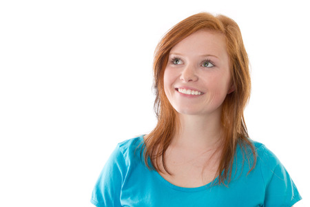 Smiling red-haired girl isolated on white