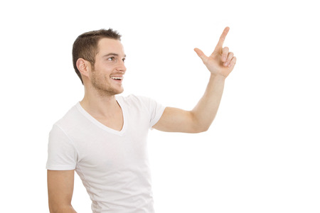 something athletic:  Man isolated in white t-shirt shows something