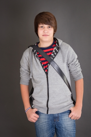 casual clothing 12 year old: Young Boy in puberty Stock Photo