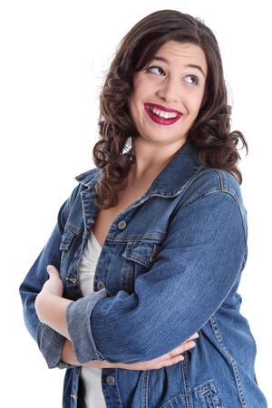 mujer gorda: Mujer joven divertida aislada en jeans Foto de archivo