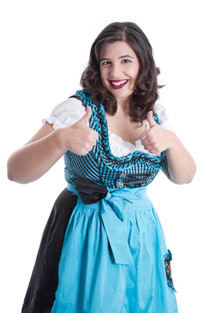 dirndl: Woman in a blue dirndl thumbs up - isolated on white Stock Photo