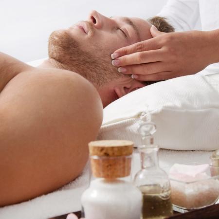 frenetic: Woman massaging a man - relaxing