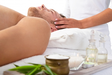 Relaxed man having massage photo
