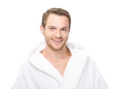 Smiling happy man in bathrobe photo