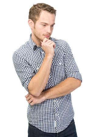 unsuccessful: Puzzled young man isolated over white in checkered shirt Stock Photo