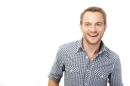 checked shirt: Laughing young man in checked shirt