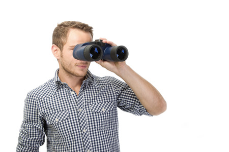 Man looking for future through binoculars - isolated on white photo