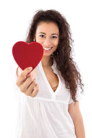 charitable:  Smiling woman with red heart isolated on white  Stock Photo