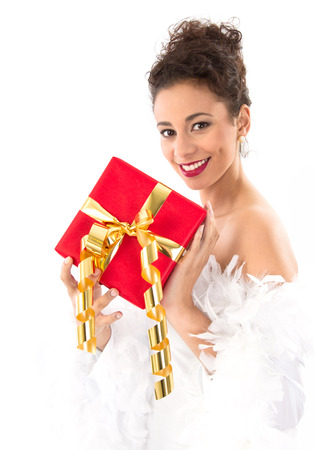 womanhood: Beautiful woman with red Christmas present, isolated on white