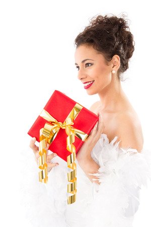 womanhood: Wonderful lady with red Christmas present, isolated on white Stock Photo