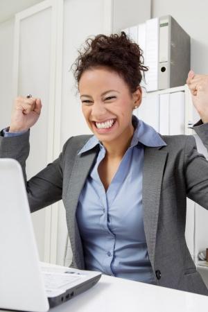 exultant: Successful job - Woman enjoying in office