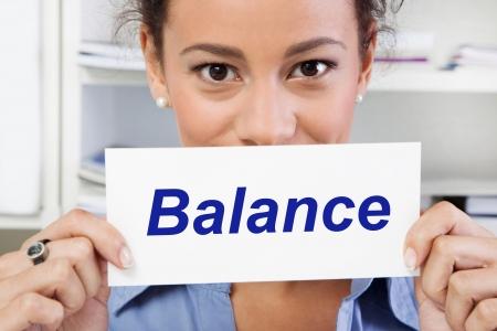 족 크   family life: Health - Balance in life - double burden and family life. Businesswoman with sign, poster, banner. Stock Photo