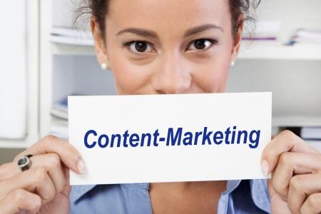 tweak: Woman holds sign - Content Marketing Stock Photo