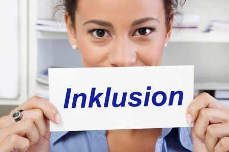 inclusion: Woman with sign inclusion in blue Stock Photo