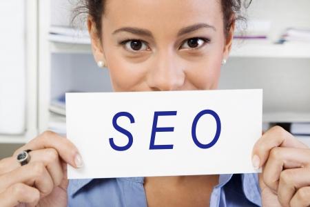 tweak:  SEO - Woman with sign in hand