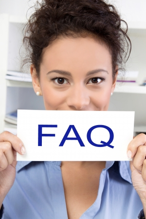 reply: Business woman with FAQ sign board