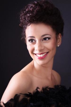 eroticism:  Multi-ethnic smiling lady in black
