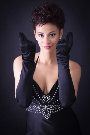 red gloves: Something else. Sexy elegant woman in black.