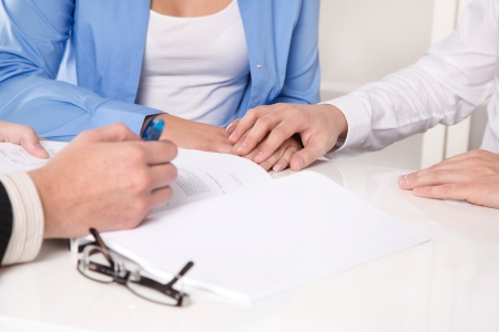 legal office: Hands - young married couple in a business meeting Stock Photo