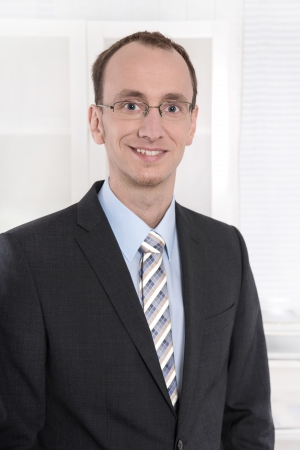finance director: Portrait of a business man in suit and tie with glasses Stock Photo