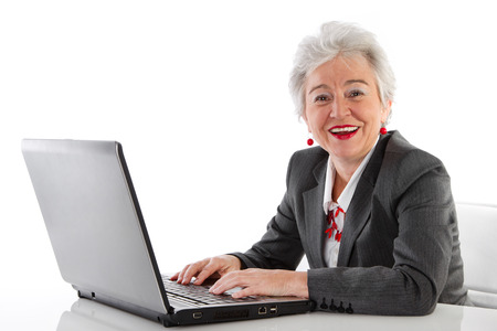 Isolated mature lady with laptop  photo
