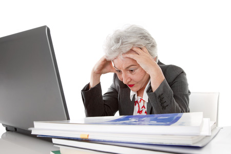 computer problem:  Older tired business woman may be all too much Stock Photo