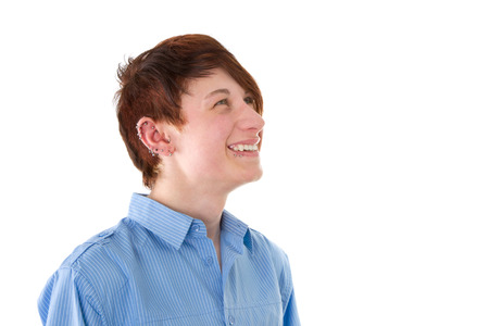 aural: Portrait of cheerful young man with piercing  Stock Photo