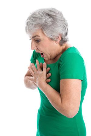 persona respirando: Mujer aislada en verde tiene dificultad para respirar Foto de archivo