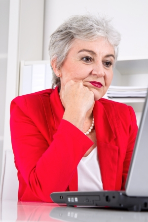 entrepreneurial: Senior business woman with laptop on workplace